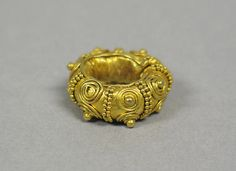 Ear Ornament, Spiral and Granular (8th-12th century). Indonesia. Gold. The Metropolitan Museum of Art, New York. Gift of Jeannette and Jonathan Rosen, 2001 (2001.794.34).