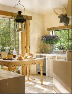 Unfitted rustic kitchen, love the trim around the door and window!