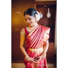 South Indian bride. Gold Indian bridal jewelry.Temple jewelry. Jhumkis. Red silk kanchipuram sari.Braid with fresh flowers. Tamil bride. Telugu bride. Kannada bride. Hindu bride. Malayalee bride.Kerala bride.South Indian wedding.