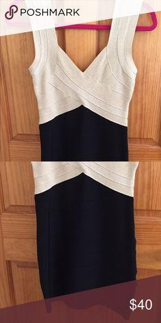 Bebe Black and Gold Bandage Dress Classic black and sparkly light gold bandage dress by Bebe. Perfect condition. bebe Dresses Mini