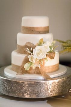 Rustic wedding cake with burlap trim / http://www.deerpearlflowers.com/rustic-country-burlap-wedding-cakes/