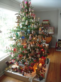 Darla & Jerry Arnold's Christmas tree done with antique ornaments, in layers of colors.