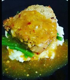 Herb crusted pork on a bed of mash and beans with an apricot, chilli & garlic sauce