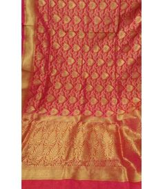 Pinkish red Golden Pure Banarasi Handloom Katan Silk Saree------The wedding day is the most special one in the life of an Indian woman. With every effort on the bride's part to look like an ethereal beauty and all those eyes on her, it is indeed a momentous occasion. Sarees have been an evergreen favorite on the Indian fashion scene. So if you are looking to adorn one on your big day, you have come to the right place.----------luxurionworld.com     Mumbai----whatsapp---  07710801701