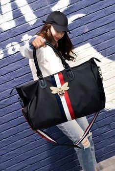 Casual Stylish Woman With Black Duffel Bag with Striped Straps - Front View Beautiful Handbags, Canvas Backpack, Travel Bags, Fashion Bags, Leather Bag, Duffel Bags, Woman, Indian Wear, Stylish