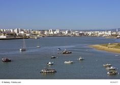 The View of Portimao, Portugal - Portimao is a town in the western Algarve, standing on the banks of River Arade and facing Ferragudo. It is a busy town and a commercial fishing port, where most of locals make a living from tourism and sardine fishing.