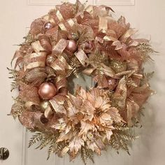 Rose Gold Mesh Tulle Christmas Wreath filled with an assortment of rose gold ornaments, ribbons, fern foliage and poinsettias to add an elegance look