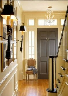 Foyer door: elephant grey~One Feng Shui cure for your stairs facing your front door is to hang a crystal chandelier from the ceiling. Inside Front Doors, Grey Front Doors, Front Door Colors, Black Interior Doors, Home Interior, Interior Colors, Gray Interior, Center Hall Colonial, Dark Doors