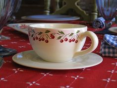 vintage cherry-patterned coffee cups with saucers
