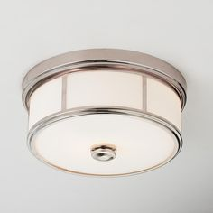 Traditional Urban Cage Ceiling Light A perfect choice for low ceilings, this sleek flush mount ceiling light features etched opal glass trimmed in your choice of Polished Nickel, Antique Gold, Brushed Nickel or Dark Bronze for sophisticated style in any room