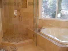 Sunken tub and shower combo with seamless shower door
