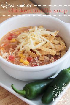 Slow cooker chicken tortilla soup from The Baker Upstairs. This soup is so easy and quick to put together, and is incredibly tasty! www.thebakerupstairs.com