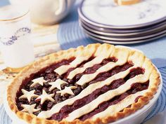 Top a juicy cherry and blueberry pie with a pastry crust cut into stars and stripes for a festive 4th of July dessert.