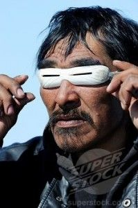 Inuit Eskimo Trying Out His New Sunglasses