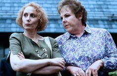 Mink Stole (as Dottie Hinkle) and Mary Jo Catlett (as Rosemary Ackerman) from John Waters' Serial Mom (1994). In the Serial Mom DVD commentary, John Waters says that Divine was intended to play Rosemary Ackerman.
