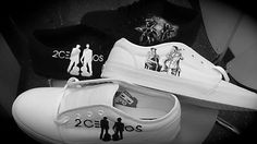 White and Black pair of Vans made for the 2 Cellos with Luka and Stjepan playing and the 2 Cello Logo.