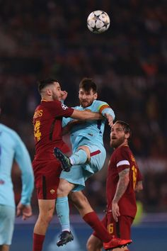 Lionel Messi of FC Barcelona competes for the ball with Manolas Kostas of AS Roma during the UEFA Champions League quarter final second leg between AS Roma and FC Barcelona at Stadio Olimpico on April 10, 2018 in Rome, Italy.