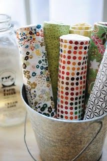 Cute way to have burp cloths out and on hand ready to go, could use basket, etc. too