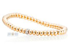 Armband aus der Flessibile Kollektion von Capolavoro. Das Mittelteil aus 750/- Weißgold mit 11 Brillanten wird von 54 Rondellen aus 750/- Rosegold eingerahmt. Aufgezogen sind die Rondellen auf einem flexiblen Zugband.