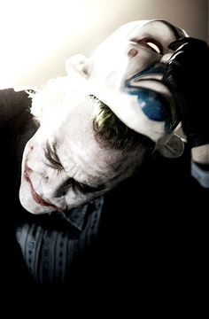 The Joker as played by Heath Ledger. Something about this photo is so chilling to me. RIP Heath.