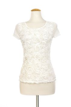 """Dressing Your Truth - Type 1 Bed of Roses Top in Ivory -  This ivory colored top features a sheer front covered rosette applique. The soft jersey back makes this great for layering with your favorite cardigans and button down tops.        100% Polyester      Cap Sleeve      Sheer Front, Knit Back      22 1/4"""" Length from top of shoulder"""