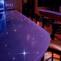 This concrete countertop by Liquid Stone Concrete Designs incorporates fiber optics for an added touch