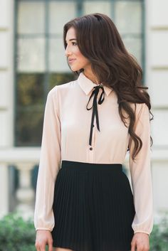 This long sleeve blush blouse is absolutely dreamy! The feminine and flirty ribbon tie makes this perfect for work or...