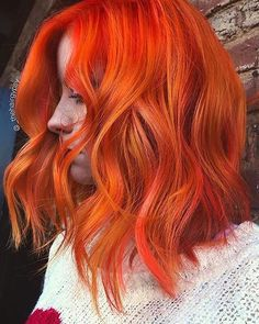 Traffic cone orange hair? Yes this will definitely stop traffic...in a good way! Hair by @_thehairgypsy with the help of @eufora.pro