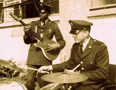 Private James Hendrix of the 101st Airborne, playing guitar at Fort Campbell, Kentucky, 1962.