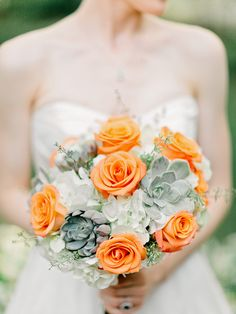 Orange and whites and greens make for a stunning bouquet | Flint Hill Wedding from Amy Arrington Photography  Read more - http://www.stylemepretty.com/georgia-weddings/2013/10/21/flint-hill-wedding-from-amy-arrington-photography/