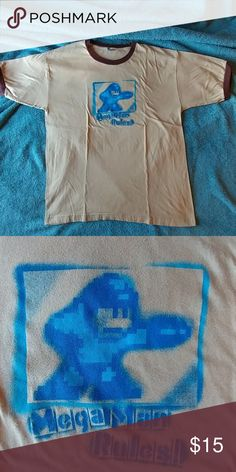 """Mega Man Ringer T-Shirt Stenciled design of Mega Man, shooting from his arm cannon. Text reads """"Mega Man Rules!"""" only worn a few times, tag has been removed. Tan/cream main color, with brown accents. Shirts Tees - Short Sleeve"""