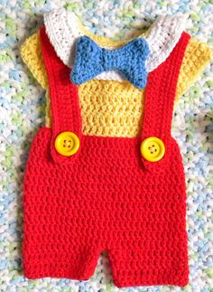 Disney's Pinocchio inspired Newborn to 3 months by OhSoVeryKnotty - I wish there was a pattern for this. It looks so cute.