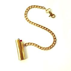 lighter necklace. Hand-cast from solid brass and plated in 14ct gold, the lighter holder is detachable and can be clipped to a bag or belt. Slip your lighter in the case for straight up fresh style 24/7 or detach and wear as a necklace!