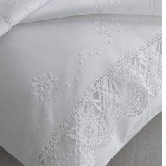 A lovely addition to a collection of white bed linen - this pair of fine crochet-edged pure cotton pillowcases.