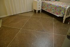 Faux paint job on basement floor. I used pin-striping tape for the lines.