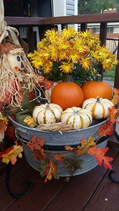 My fall display.  I used an old wash tub, mums, and pumpkins.  The leaf garland is from the local dollar store.  Mr. Scarecrow was a freebie from a friend.