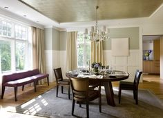 Dining Room: custom wainscotting, metallic ceiling; opening to Butler's Pantry in background.