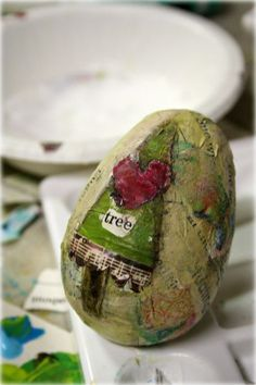Go get some plastic eggs at discount prices now and use them to make THESE lovely decoupage eggs for your holiday tree !!!
