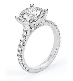 Prongs around the halo, interesting. --Michael M. Engagement Rings - R538