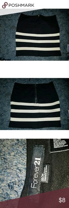 Black Skirt Black skirt with three creme strips. Has a zipper on the back. In good condition, only worn once!  Size: Medium  Brand: Forever 21 Forever 21 Skirts Midi