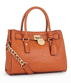 """Michael Kors, great color and trimmed in """"Gold"""".  Love it."""