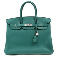 This Authentic Hermès 35 cm Birkin is in pristine unworn condition with the protective plastic intact on the hardware. Hermès bags are considered the ultimate luxury item the world over. Hand stitched by skilled craftsmen, wait lists of a year or more are commonplace. This particular Birkin is in Malachite Togo leather; the newest shade of mesmerizing deep green. Price: $24,900