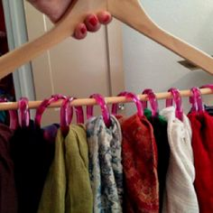 Organize Scarfs for under $5. Shower rid rings and a hanger. Durh
