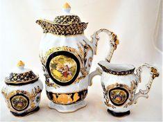 Vintage Limoges Tea Set-in Cobalt Blue, White, & Gold. French Porcelain Teapot, Sugar Bowl w/ Lid, Creamer/Jug. Circa Scenes of courting couples. Cobalt Blue, Blue Gold, White Gold, Tea Sets Vintage, Vintage Teapots, Porcelain Dolls Value, China Sets, Tea Service, Chocolate Pots