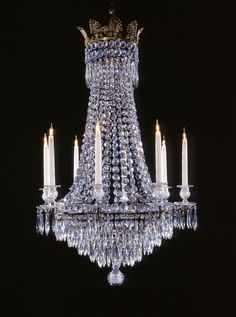 A Regency style tent and waterfall chandelier typical of the early 1800s  For 8 lights, with cut glass nozzles and pans, dressed with icicles and octagonal flatback buttons.