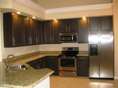 The Right Ideas for the Dark Painted Kitchen Cabinets with the faucet