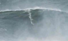 The Hawaiian surfer Garrett McNamara has claimed to have broken his own world record after surfing a giant wave off the coast of Portugal