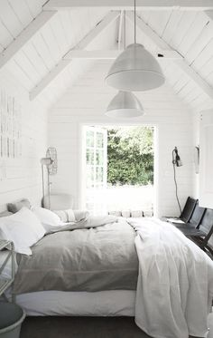 = grey linen, black chairs and white walls