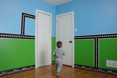 Little boy's car-themed bedroom!  We couldn't find decals we liked, so we painted it all by hand!  Very, very happy little guy!