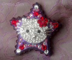 """""""Hello, Kitty"""";  Cosmic Clay by Spirit Spellweaver --Clay & Swarovski Crystal Star Pendant featuring a vintage silver and crystal Hello Kitty charm. Sold."""